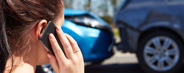 woman-on-phone-after-car-accident